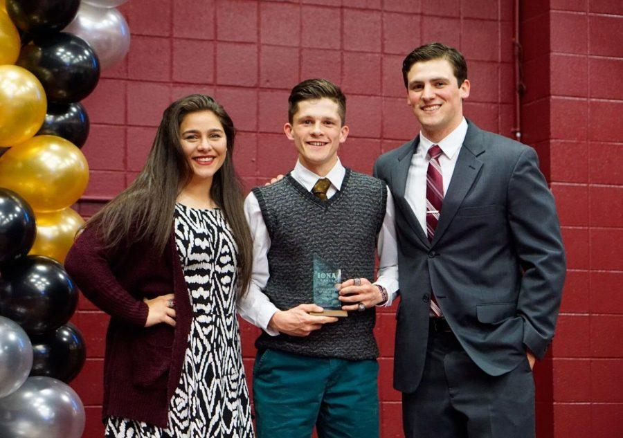Junior Liam Dee receives the Male Athlete of the Year award at the Gaelspys