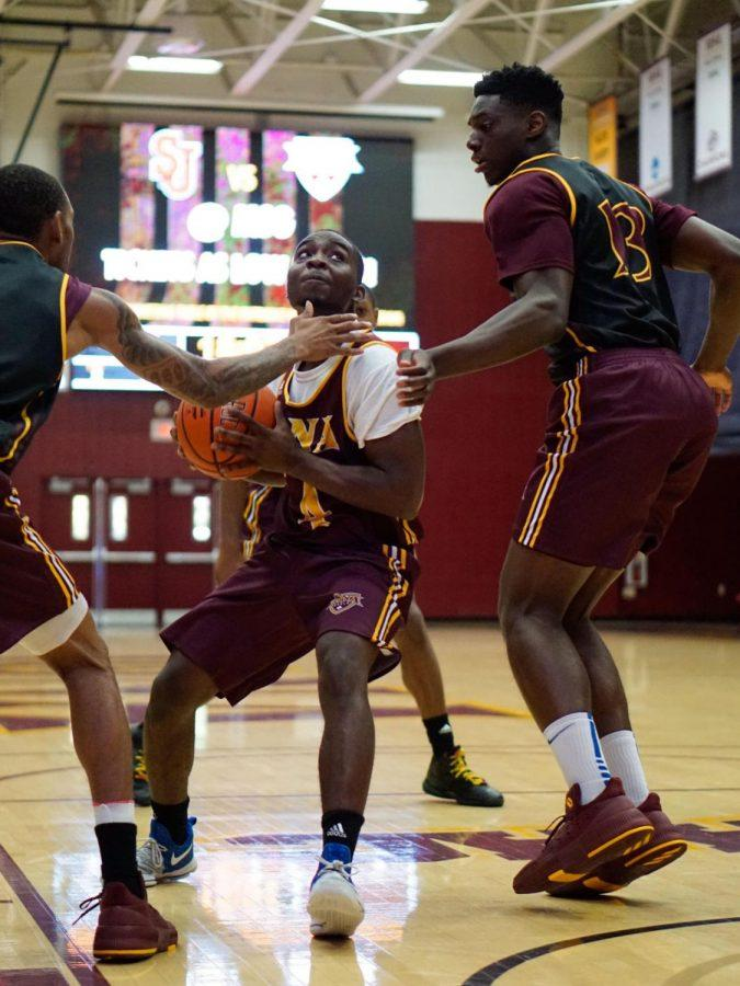 Junior guard Schadrac Casimir drives to the basket during the Maroon and Gold game.