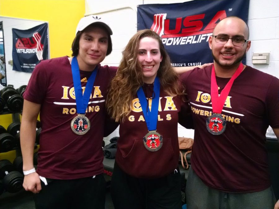 Junior Adrian Lasso (left), junior Melissa Mulholland (middle) and freshman Felix Paredes (right) received medals at the USPA Powerlifting Meet on Dec. 4
