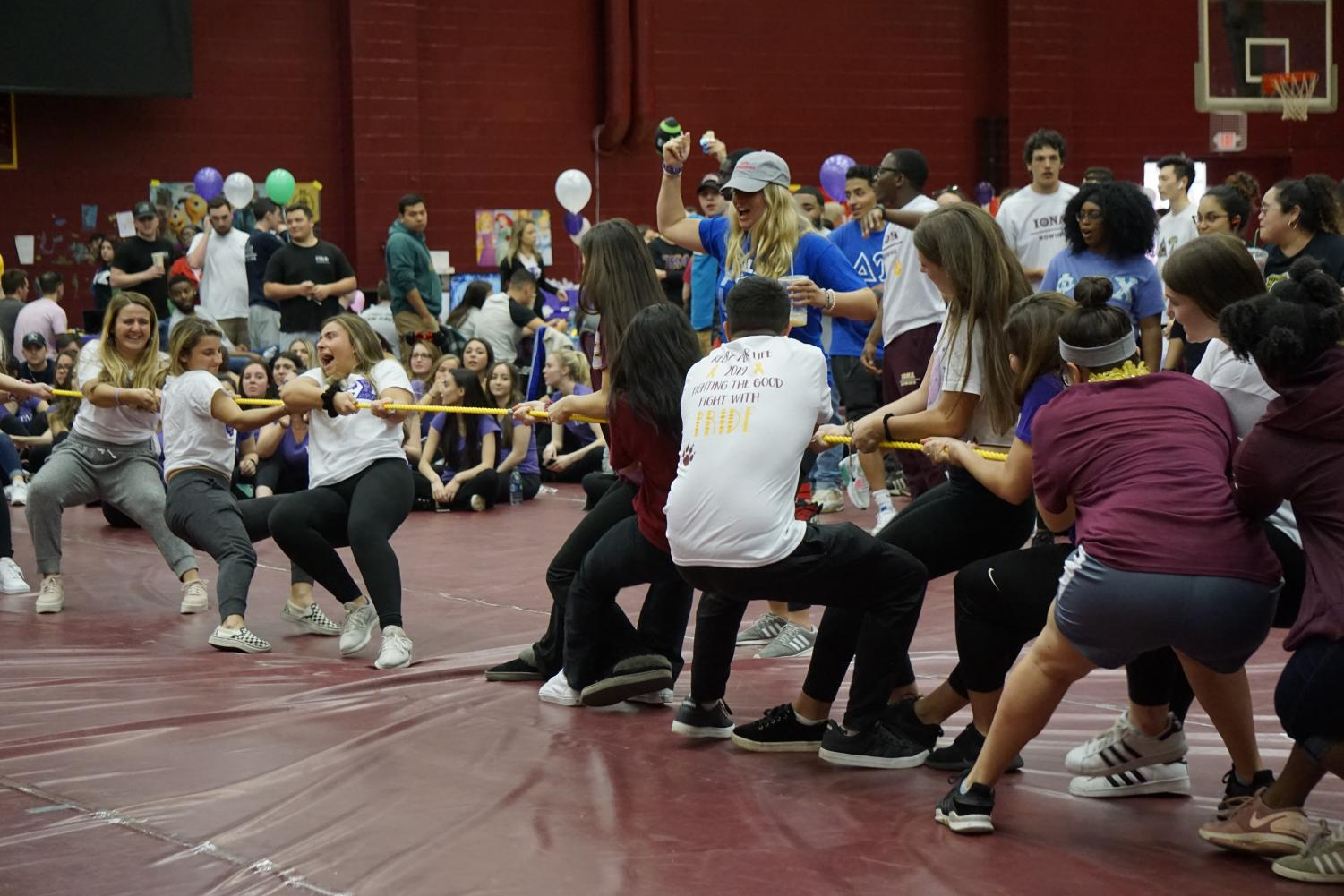 Iona Relay participants take part in a tug-of-war competition, which was one of the many activities that Iona students could participate in during the event.