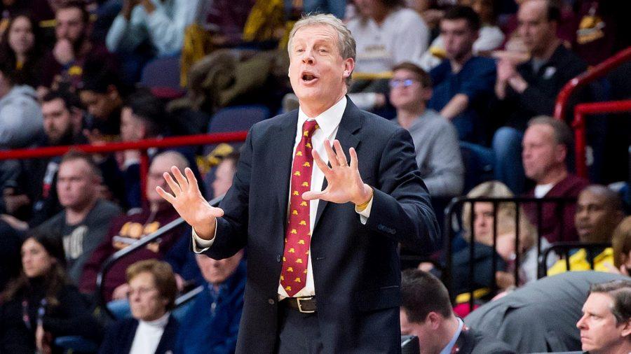 Head Coach Tim Cluess coaches the men's basketball team for his ninth season.