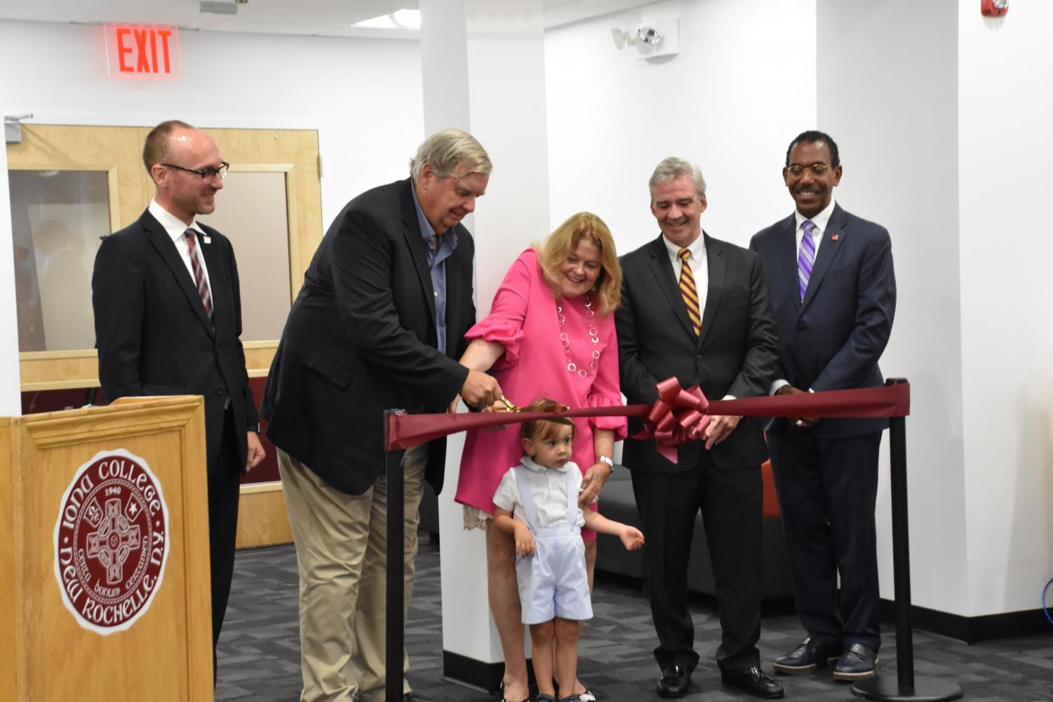 James and Anne Marie Hynes (center) but the ribbon for the grand opening of the Hynes Entrepreneurship Center.
