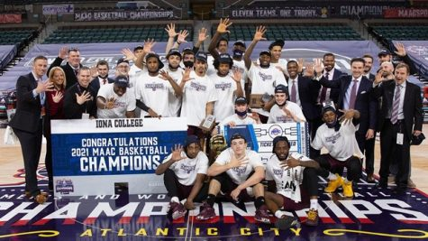 The Iona men's basketball team celebrating a 60-51 win over Fairfield in the Metro Atlantic Athletic Conference men's basketball championship game in Boardwalk Hall, Atlantic City, New Jersey. The win gave the Gaels their fifth consecutive MAAC championship and an automatic bid to the Round of 64 game against Alabama