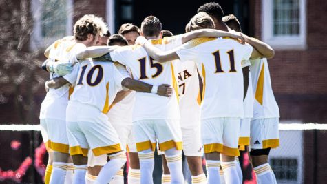 Iona men's soccer team huddling up during their March 25 game against Manhattan College at Van Cortlandt Park in Riverdale, NY.
